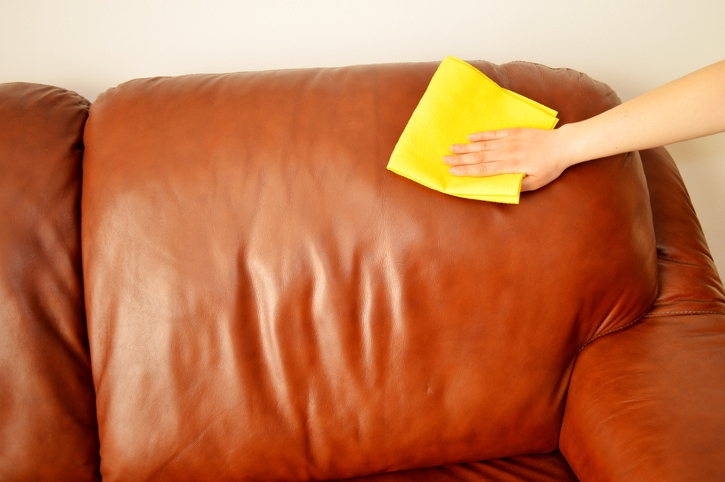 wiping down leather couch