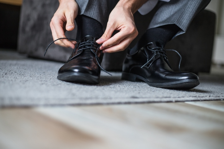 tying leather shoes